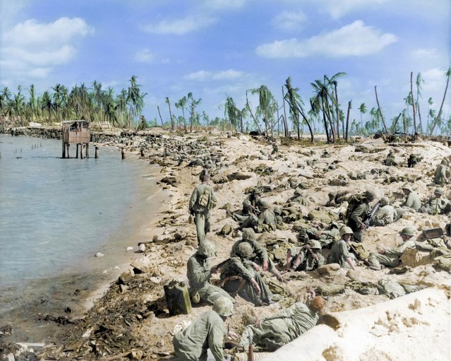 US marines huddled on the beaches during the Battle of Tarawa in World War Two, Kiribati, 1943. There were around 4,600 fatalities recorded following the bloody battle. (Photo by Royston Leonard/Mediadrumworld)