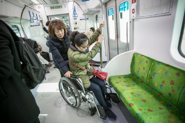 Kim Shi-nyeo, left, mother of Han Hye-gyeong, 39, right, assists her daughter to sit down on a wheelchair as they approach to a subway stop on the way to Samsung Electronic's Seocho Headquarters on March 6, 2017 in Seoul, South Korea. Han worked at Samsung's Giheung LCD factory from 1995 and 2001, and was diagnosed as brain tumor in 2005. She had undergone a surgery and a series of chemotherapy, but became both mentally and physically disabled and could not walk on her own. (Photo by Jean Chung/Getty Images)