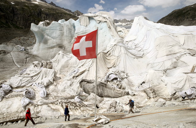 White canvas covers parts of the Rhone glacier to protect against melting near the Furka mountain pass at 2429 meters (7969 ft) altitude in the Swiss Alps, Switzerland August 6, 2015. (Photo by Arnd Wiegmann/Reuters)