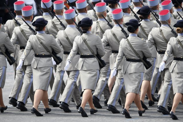 Soldiers of the National Active Non-Commissioned Officers School march during the traditional Bastille Day parade on the Champs Elysees avenue in Paris, July 14, 2014. (Photo by Charles Platiau/Reuters)