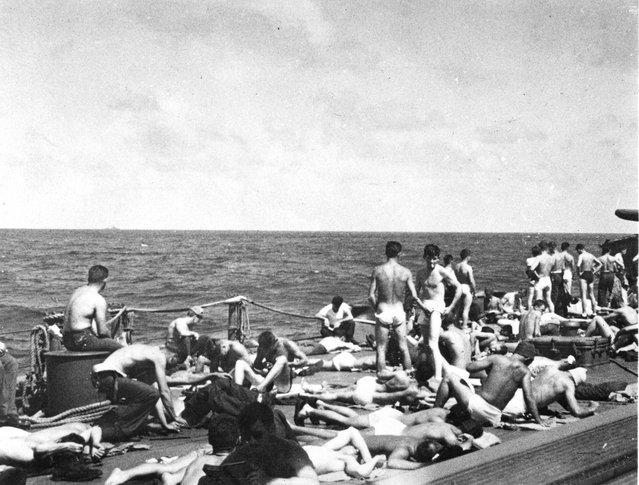 Crew sunbathing underway, port side of quarterdeck