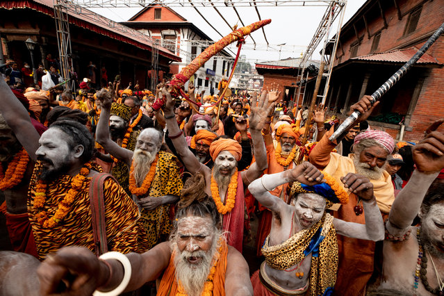 A group of Sadhus, Hindu holy people, take part in a religious rally to mark the annual Hindu festival of Maha Shivratri, at Pashupati Temple in Kathmandu, Nepal, 19 February 2020. Maha Shivratri festival, which is celebrated on 21 February, sees Hindu devotees, from across the country and neighboring India, gather to celebrate the birthday of Lord Shiva, the Hindu god of creation and destruction, by offering special prayers and fasting. (Photo by Narendra Shrestha/EPA/EFE)