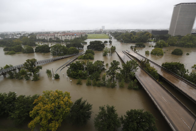 An overhead view of the flooding in Houston, from Buffalo Bayou on Memorial Drive and Allen Parkway, as heavy rains continued falling from Tropical Storm Harvey, Monday, August 28, 2017, in Houston. Houston was still largely paralyzed Monday, and there was no relief in sight from the storm that spun into Texas as a Category 4 hurricane, then parked itself over the Gulf Coast. (Photo by Karen Warren/Houston Chronicle via AP Photo)