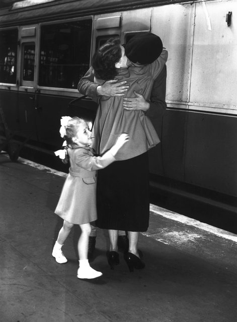 National Serviceman Tony Kemp of Bermondsey is greeted by his fiancee, on his return from Korea, at Waterloo, London, 1952. (Photo by Terry Fincher)