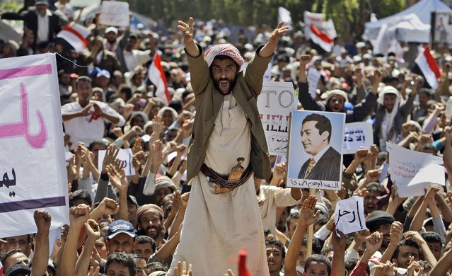 An anti-government protestor reacts as he and other demonstrators shout slogans during a demonstration demanding the resignation of Yemeni President Ali Abdullah Saleh, in Sanaa, Yemen on March 1, 2011. (Photo by Muhammed Muheisen/AP Photo)