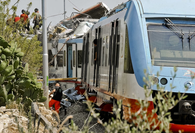 A view of the scene of a train accident after two commuter trains collided head-on near the town of Andria, in the southern region of Puglia, killing several people, Tuesday, July 12, 2016. (Photo by Luca Turi/ANSA via AP Photo)