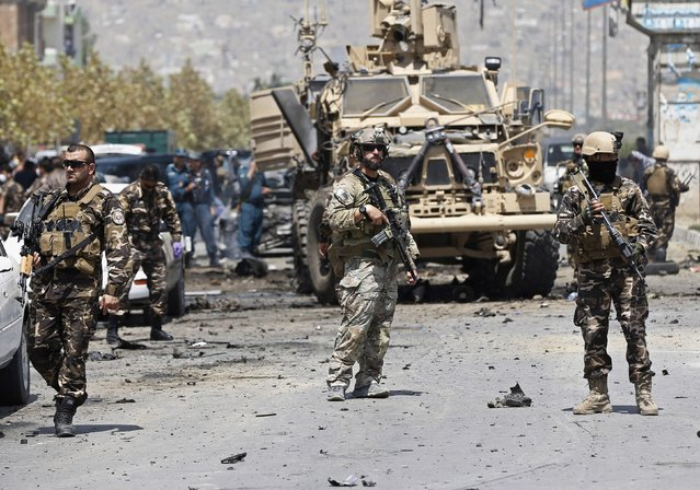 NATO troops arrive at the site of a suicide car bomb attack in Kabul August 10, 2014. A suicide car bomber targeted a convoy of foreign forces in the capital Kabul on Sunday, killing at least four Afghan civilians, including children, and wounding dozens, Afghan security officials said. (Photo by Omar Sobhani/Reuters)
