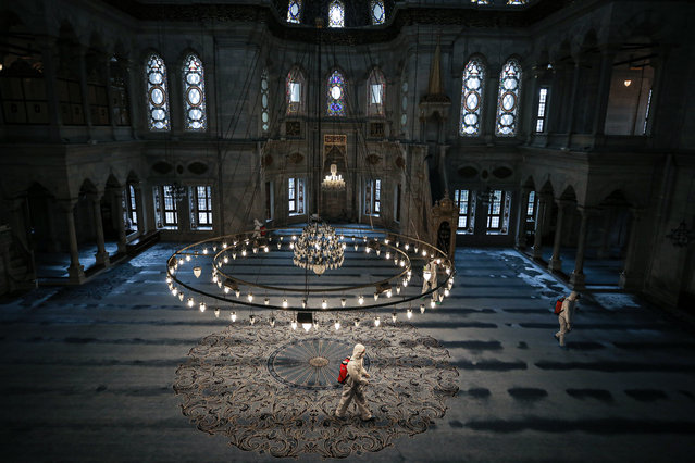 Officials of Fatih Municipality carry out disinfection works as part of precautions against the coronavirus (COVID-19), on March 19, 2020 at Nuruosmaniye Mosque in Istanbul, Turkey. (Photo by Salih Zeki Fazlioglu/Anadolu Agency via Getty Images)