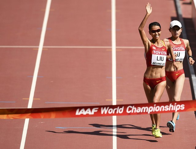 Liu Hong of China (L) celebrates on her way to the finish line as she wins the women's 20 km race walk final ahead of Lu Xiuzhi of China during the 15th IAAF World Championships at the National Stadium in Beijing, China August 28, 2015. (Photo by Dylan Martinez/Reuters)