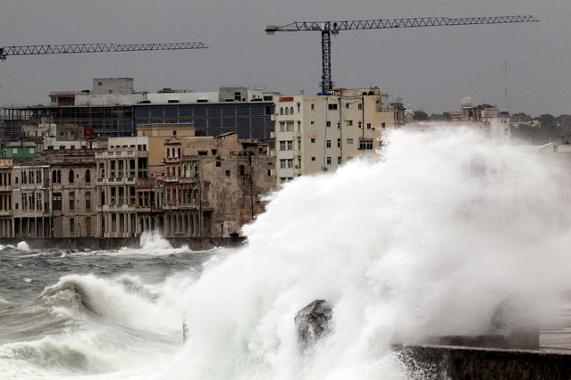 Waves crash against the seafront boulevard El Malecon ahead of the passing of Hurricane Irma, in Havana, Cuba September 9, 2017. (Photo by Reuters/Stringer)