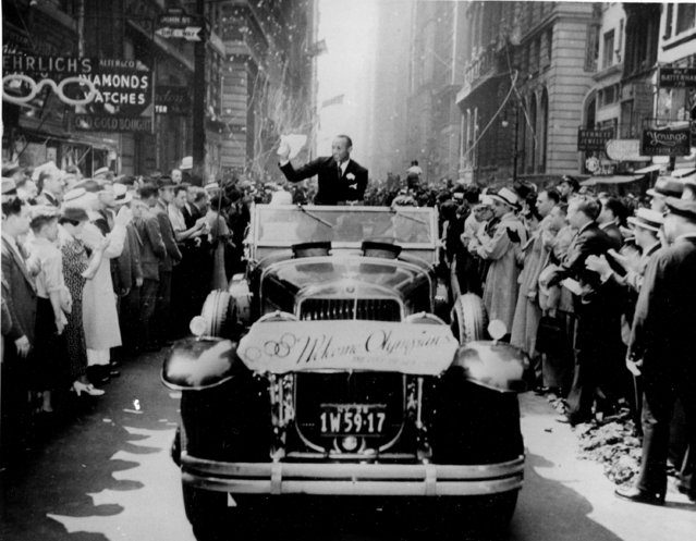 Olympic gold medal winner Jesse Owens waves from an open car during a ticker tape parade along Broadway in New York City on September 3, 1936. The twenty-two-year-old won four gold medals at the Summer Olympics in Berlin, Germany. (Photo by AP Photo)