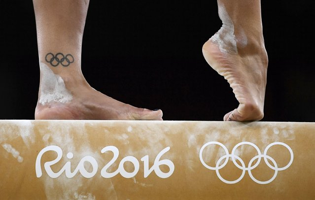 2016 Rio Olympics, Gymnastics training, Rio Olympic Arena, Rio de Janeiro, Brazil on August 4, 2016. Close up of the feet of Rebecca Downie (GBR) of United Kingdom as she trains on the beam. (Photo by Dylan Martinez/Reuters)