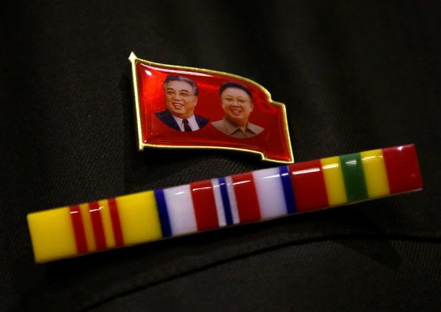 A North Korea fan wears a pin of North Korea founder Kim Il Sung and late leader Kim Jong Il during a North Korea fan event in Tokyo, Japan on November 2, 2017. (Photo by Toru Hanai/Reuters)