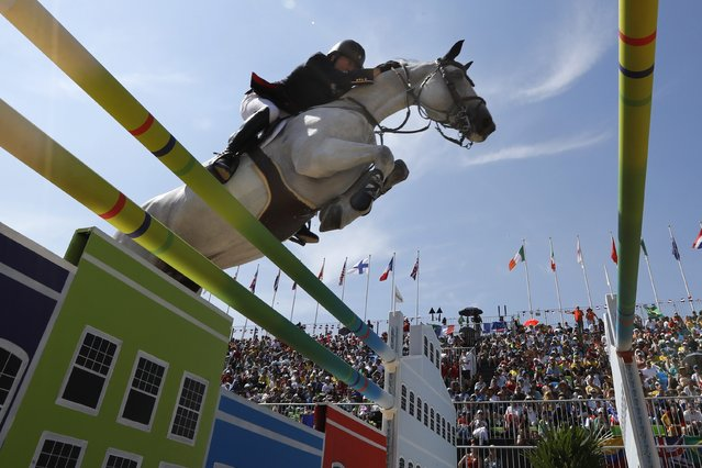 Michael Witaker of Great Britain riding Cassionato performs during the Jumping Individual competition of the Rio 2016 Olympic Games Equestrian events at the Olympic Equestrian Centre in Rio de Janeiro, Brazil, 16 August 2016. (Photo by Jim Hollander/EPA)