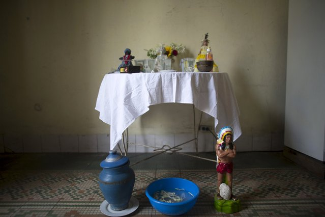An altar produced for a ceremony of the Afro-Cuban religion Santeria to attract spirits of dead ancestors to ask for guidance is seen in a house in downtown Havana, August 18, 2015. (Photo by Alexandre Meneghini/Reuters)