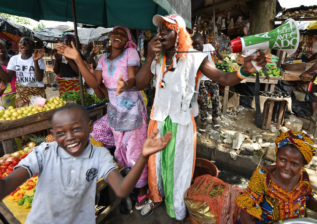 4: Abidjan, Ivory Coast. Latest ranking: 128; Ranking five years ago: 131; Five-year index movement: 3.8%. Here: A supporter of Ivory Coast president Alassane Ouattara campaigns in a market in the city's Koumassi quarter. (Photo by Sia Kambou/AFP Photo)