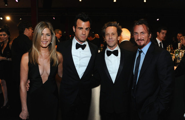 (L-R) Actors Jennifer Aniston and Justin Theroux, producer Brian Grazer, and actor Sean Penn attend LACMA 2012 Art + Film Gala Honoring Ed Ruscha and Stanley Kubrick presented by Gucci at LACMA on October 27, 2012 in Los Angeles, California. (Photo by Stefanie Keenan)