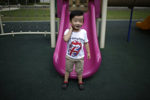 Xin Zhiteng, who was born in 2012, poses for a photograph in Shanghai August 30, 2014. Zhiteng did not say if he would like to have siblings. (Photo by Carlos Barria/Reuters)