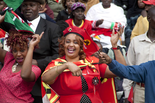 Supporters of Jubilee Party celebrate during the inauguration ceremony of Uhuru Kenyatta his second term as president of Kenya at Moi International Sports Complex in Nairobi, Kenya Tuesday, November 28, 2017. Kenyatta is being sworn in on Tuesday, ending a months-long election drama that saw the first vote nullified by the country's top court and the second boycotted by the opposition. (Photo by Sayyid Abdul Azim/AP Photo)