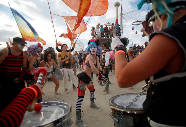 Members of the Trash Kan Marchink Band perform as approximately 70,000 people from all over the world gather for the 30th annual Burning Man arts and music festival in the Black Rock Desert of Nevada, U.S. August 29, 2016. (Photo by Jim Urquhart/Reuters)