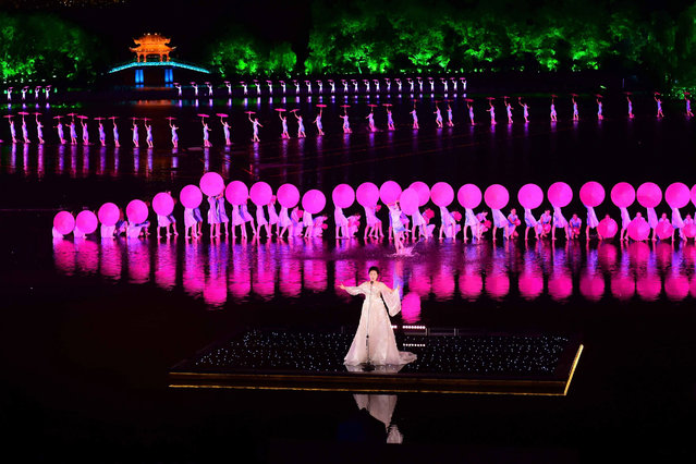 In this Sunday, September 4, 2016 photo released by Xinhua News Agency, Chinese artists perform during an evening gala for the G20 Summit at the West Lake in Hangzhou in eastern China's Zhejiang province. (Photo by Zhang Duo/Xinhua via AP Photo)