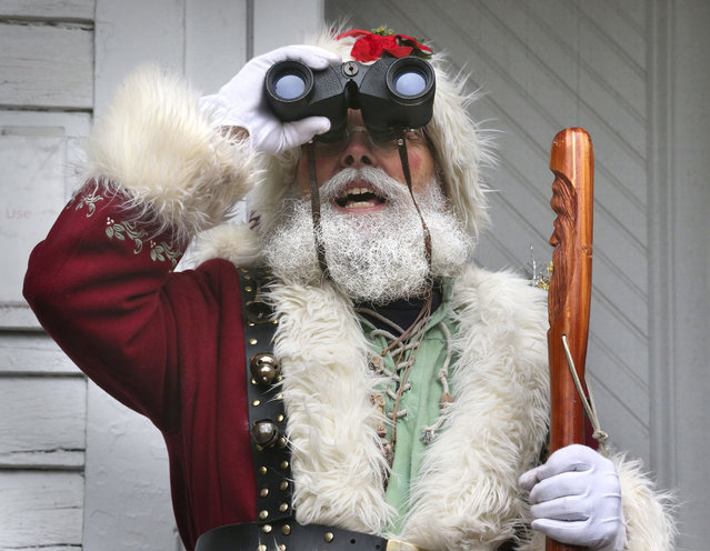 Tom Ford of Luray, Va., dressed as Santa, takes part in the annual Bird Count and Family Festival at the State Arboretum of Virginia at Blandy Experimental Farm in Boyce, Va. Sunday, December 17, 2017. (Photo by Jeff Taylor/The Winchester Star via AP Photo)