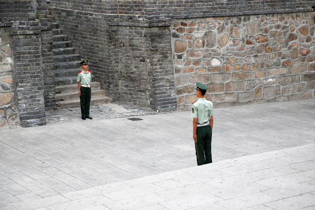 Security personnel keep watch at a section of the Great Wall before a visit by Canadian Prime Minister Justin Trudeau (not pictured) and his family in Badaling, north of Beijing, China, September 1, 2016. (Photo by Thomas Peter/Reuters)