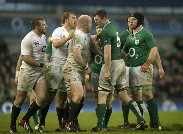 England's prop Dan Cole (3L) goes head to head with Ireland's lock Donnacha Ryan (2R) during the Six Nations international rugby union match between Ireland and England at the Aviva Stadium in Dublin on February 10, 2013. England won the game 12-6. (Photo by Adrian Dennis/AFP Photo)