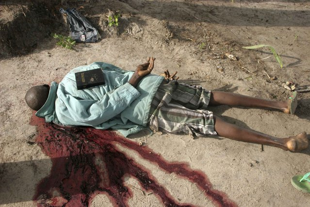 A Bible placed by gunmen is seen on the back of the slain body of a man after an attack in Hindi village, near Kenya's coastal town of Lamu, in this July 6, 2014 file photo. (Photo by Abdalla Barghash/Reuters)