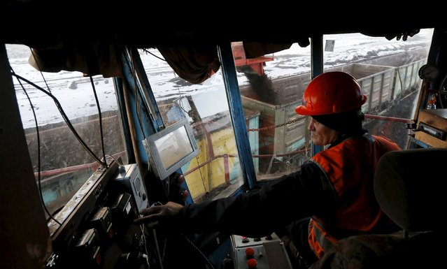 Machinist of a loading mechanism Sergey Volkov operates a rotary dredge which loads wagons with coal at the Borodinsky opencast colliery, near the Siberian town of Borodino, east of Krasnoyarsk, Russia October 27, 2015. (Photo by Ilya Naymushin/Reuters)