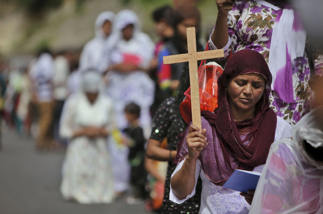 Indian Christian devotees pray on Good Friday in Jammu, India, Friday, March 29, 2013. Christians all over the world are marking Good Friday, the day when Jesus Christ was crucified. (Photo by Channi Anand/AP Photo)