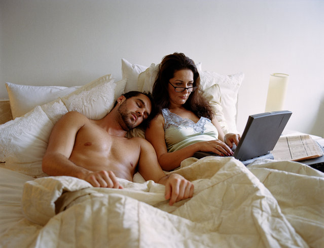 Young man and mature woman in bed, woman using laptop. (Photo by Betsie Van der Meer/Getty Images)
