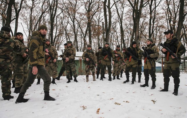 """Pro-Russian separatists from the Chechen """"Death"""" battalion take part in a training exercise in the territory controlled by the self-proclaimed Donetsk People's Republic, eastern Ukraine, December 8, 2014. (Photo by Maxim Shemetov/Reuters)"""