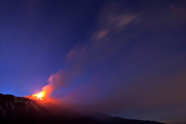 Italy's volcanic Mount Etna spews lava during an eruption on the southern Italian island of Sicily April 11, 2013. Mount Etna is Europe's tallest and most active volcano. Picture taken April 11, 2013. (Photo by Antonio Parrinello/Reuters)