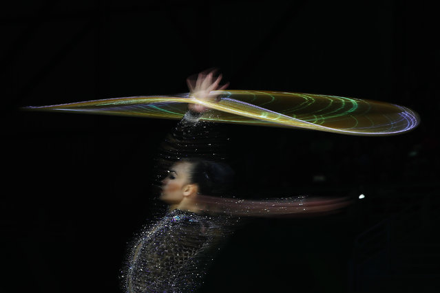 Kwan Dict Weng of Malaysia performs with the hoop in the Individual All-Around Final during Rhythmic Gymnastics on day eight of the Gold Coast 2018 Commonwealth Games at Coomera Indoor Sports Centre on April 12, 2018 on the Gold Coast, Australia. (Photo by Hannah Peters/Getty Images)