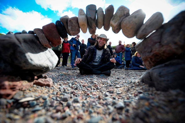 Overall winner, Pedro Duran from Spain, competes in the European Stone Stacking Championships 2018 in Dunbar, Scotland, on April 22, 2018. (Photo by Andy Buchanan/AFP Photo)
