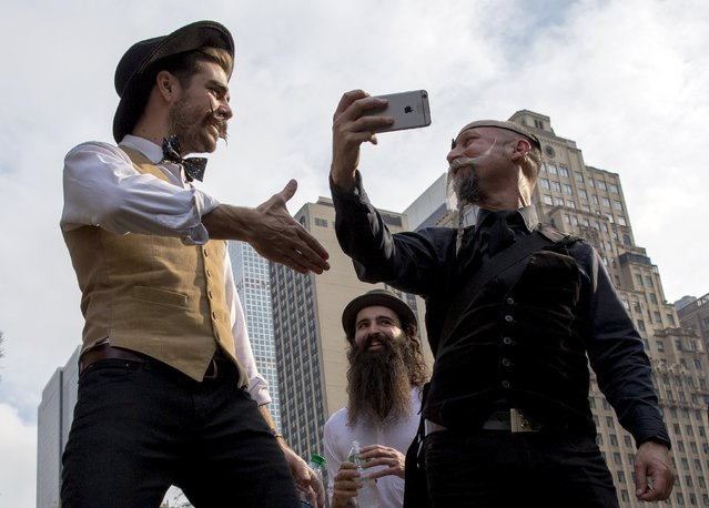 Contestants gather to promote the National Beard and Moustache Championships in New York November 6, 2015. (Photo by Brendan McDermid/Reuters)