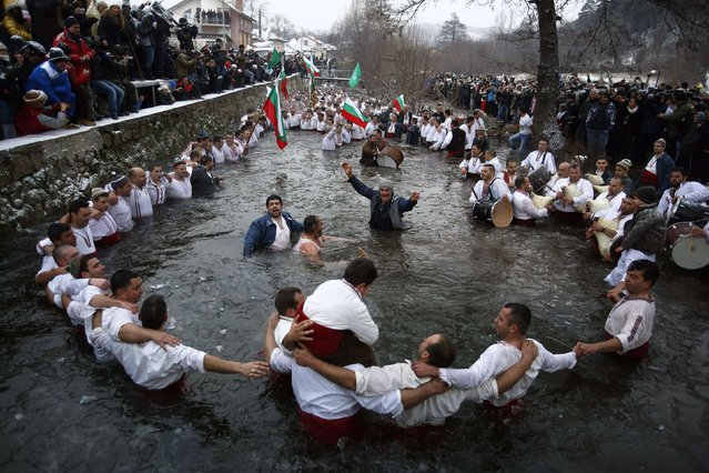 Bulgarian men dance in the icy waters of the Tundzha river during a celebration to commemorate Epiphany Day in the town of Kalofer January 6, 2015. (Photo by Stoyan Nenov/Reuters)