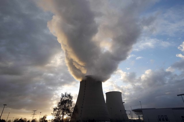 Steam rises at sunset from the cooling towers of the Electricite de France (EDF) nuclear power station at Nogent-Sur-Seine, France, November 13, 2015. The nuclear industry argues world leaders at the COP21 conference in Paris next week should not have to choose between nuclear and renewables but between low-carbon energy, including nuclear, and fossil fuels. Paris will host the World Climate Change Conference 2015 (COP21) from November 30 to December 11. (Photo by Charles Platiau/Reuters)
