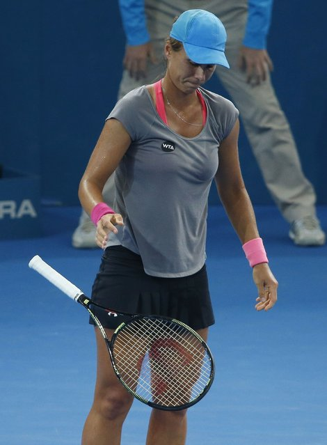 Varvara Lepchenko of the U.S. drops her racquet after losing a point during her women's singles semi final match against Ana Ivanovic of Serbia at the Brisbane International tennis tournament January 9, 2015. (Photo by Jason Reed/Reuters)