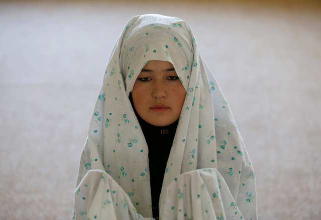 Female soldier Mohazama Najebi, 18, from the Afghan National Army (ANA), prays inside a mosque at the Kabul Military Training Centre (KMTC) in Kabul, Afghanistan, October 26, 2016. (Photo by Mohammad Ismail/Reuters)