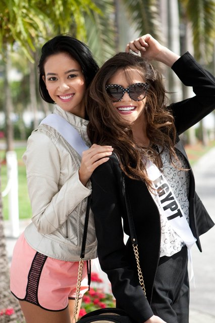 This picture provided by the Miss Universe Organization shows Elvira Devinamira (L), Miss Indonesia 2014, and Lara Debbane (R), Miss Egypt 2014, posing for photographs at the Trump National Doral Miami on January 8, 2015, poses for photographs in her Yamamay for Miss Universe Swimwear at the Trump National Doral Miami on January 7, 2015 in Florida. (Photo by AFP Photo/Miss Universe Organization)
