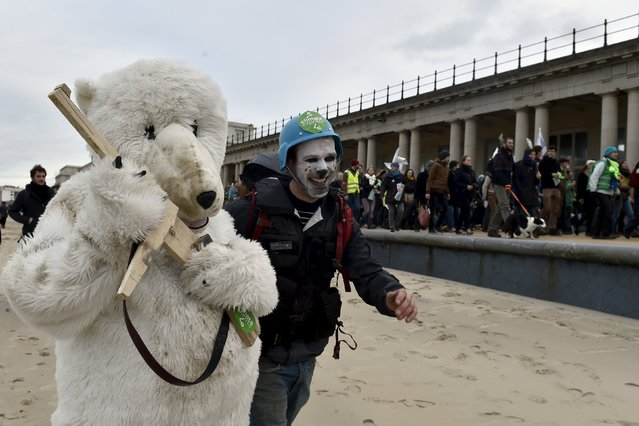 Performers walk during a march against climate change in Ostend, Belgium, December 6, 2015. (Photo by Eric Vidal/Reuters)