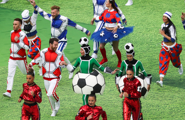 Dancers enjoy themselves during the opening ceremony before the Russia 2018 World Cup Group A football match between Russia and Saudi Arabia at the Luzhniki Stadium in Moscow on June 14, 2018. (Photo by Stanislav Krasilnikov/TASS via Getty Images)