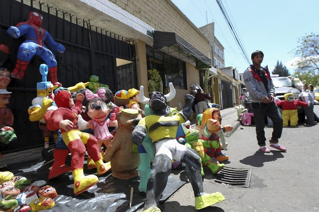 Effigies are seen at a stall in preparation for New Year's eve in Quito December 30, 2015. (Photo by Guillermo Granja/Reuters)