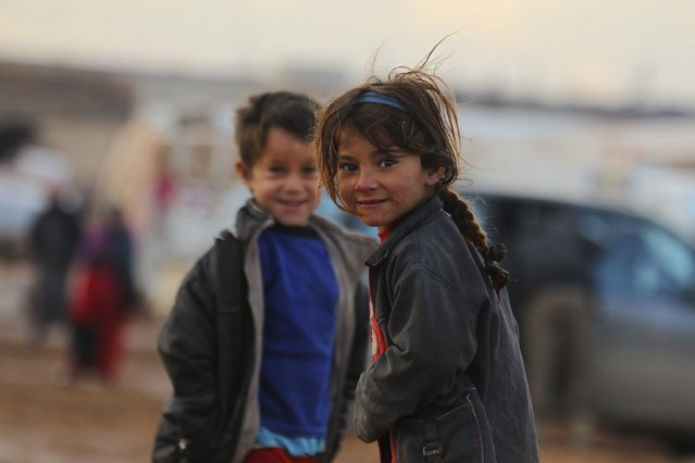 Internally displaced Syrian children play inside a refugee camp in the Hama countryside, Syria January 1, 2016. (Photo by Ammar Abdullah/Reuters)