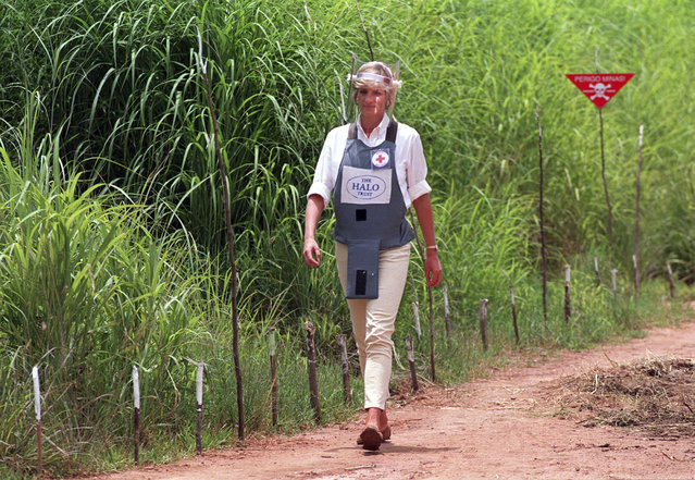 In this January 15, 1997 file photo, Princess Diana, wearing a bombproof visor, visits a minefield in Huambo, in Angola. Prince Harry on Friday Sept. 27, 2019, is following in the footsteps of his late mother, Princess Diana, whose walk through an active mine field in Angola years ago helped to lead to a global ban on the deadly weapons. (Photo by John Stillwell/PA Wire via AP Photo/File)