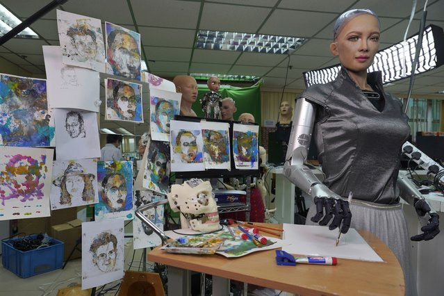 Sophia's artworks are displayed at Hanson Robotics studio in Hong Kong on March 29, 2021. Sophia is a robot of many talents — she speaks, jokes, sings and even makes art. In March, she caused a stir in the art world when a digital work she created as part of a collaboration was sold at an auction for $688,888 in the form of a non-fungible token (NFT). (Photo by Vincent Yu/AP Photo)