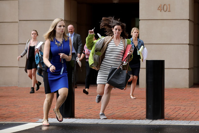 Journalists run out of the Albert V. Bryan U.S. Courthouse during the trial of former Trump campaign chairman Paul Manafort during the fourth day of jury deliberation August 21, 2018 in Alexandria, Virginia. Manafort has been charged with bank and tax fraud as part of special counsel Robert Mueller's investigation into Russian interference in the 2016 presidential election. (Photo by Chip Somodevilla/Getty Images)