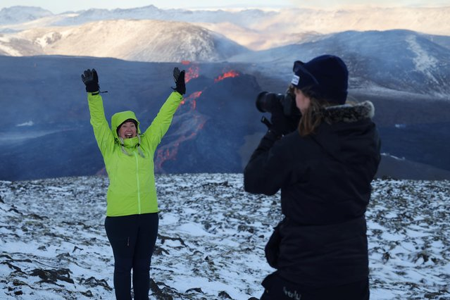 Tourists take pictures at a volcanic site on the Reykjanes Peninsula following recent eruptions, in Iceland on March 26, 2021. (Photo by Cat Gundry-Beck/Reuters)